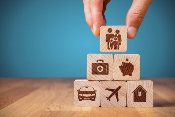 Six Common Coverage Gaps What Are You Missing - Stacked Wood Blocks With Insurance Icons Painted On The Front